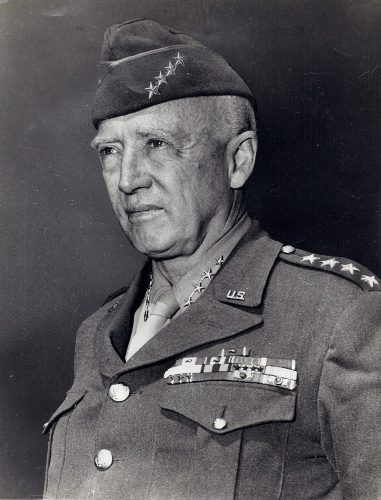 General George S Patton wearing his 4-star service cap.