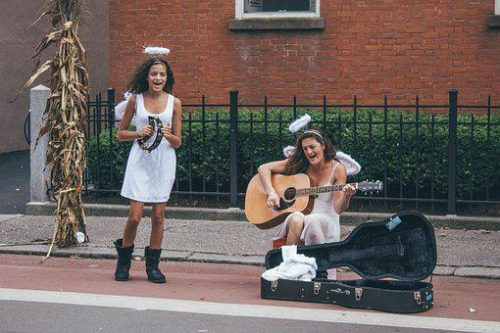 2 street musicians with halos of sainthood