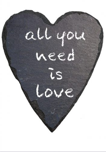 All you need is love, in white chalk on heart-shaped slate