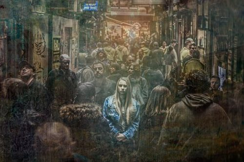 woman appearing anxious in a crowd