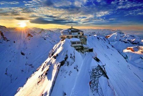 Hotel on top of a snowy mountain
