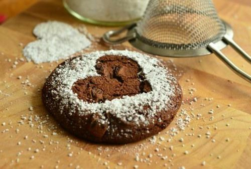 Chocolate cookie with heart sugar dusting