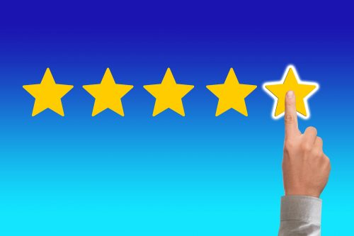 Finger selecting 5-star rating