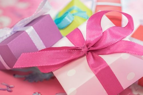 Colorful array of gift boxes wrapped with bows