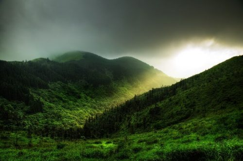 light shining on green hills