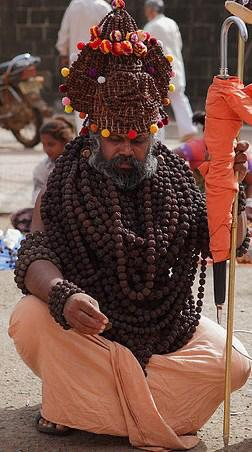 Man wearing many mala beads