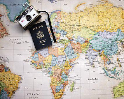 camera and passport on a world map