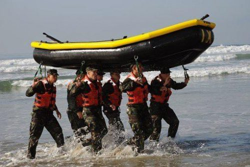 6 Navy Seals carrying raft