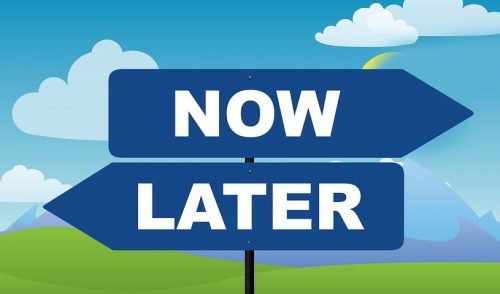 Now vs later sign