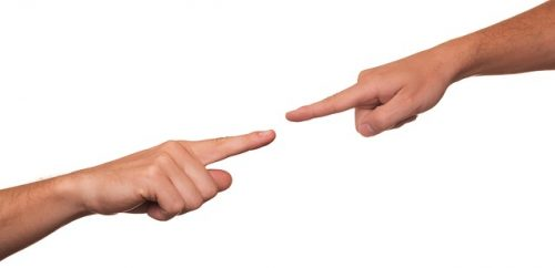 2 hands pointing in disagreement