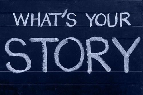 What's Your Story, chalk text on blackboard