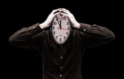 Man with a clock for a head.
