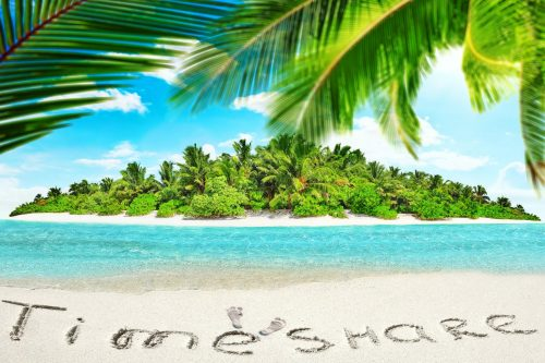 Timeshare written in sand on a tropical island