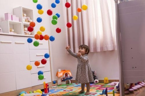 Girl playing with toys.