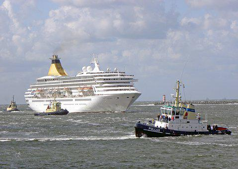 tug boats and cruise ship