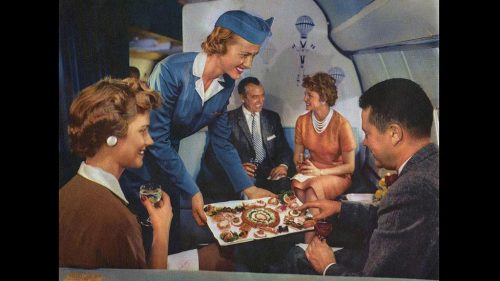 retro pic of an air hostess serving