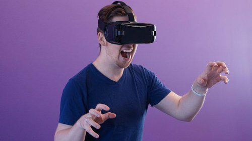 Man playing in Virtual Reality