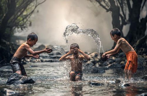 3 boys playing in water