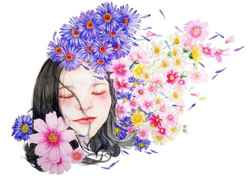 Dreaming woman surrounded by flowers