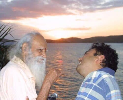 Satish Daryanani amusing Swami Satchidananda on a boat.