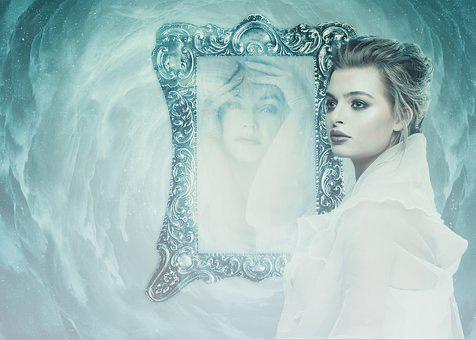 Beautiful woman reflecting in a mirror that shows her inner feelings