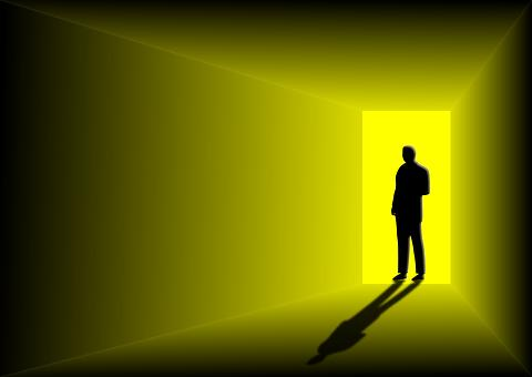 Man walking through a door into yellow light.